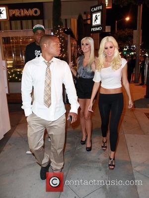 Sam Jones with Karissa and Kristina Shannon  Celebrities leaving the Lemon Basket Restaurant Los Angeles, California - 10.05.11