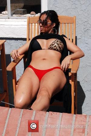 Liana Mendoza enjoys a day at Hermosa Beach Los Angeles, California - 12.05.11