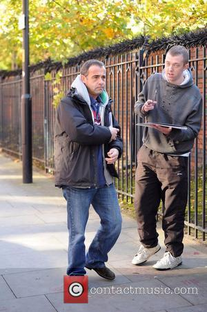 Coronation Street actor Michael Le Vell signs autographs for young fans outside the Granada Studios in Manchester. Le Vell, who...