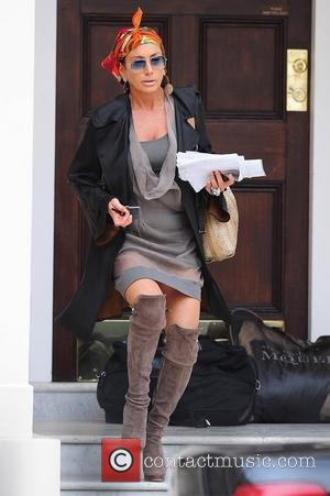 Nancy Dell'Olio leaving her house wearing an orange scarf and a revealing, partially see-through dress  London, England - 08.09.11