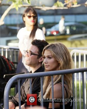 Delta Goodrem watches her boyfriend performing at a concert sponsored by Microsoft at the Westfield shopping Centre Century City, California...