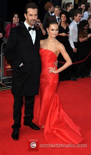 Rupert Everett and Kara Tointon at the 2011 Olivier Awards at  the Theatre Royal London, England- 13.03.11