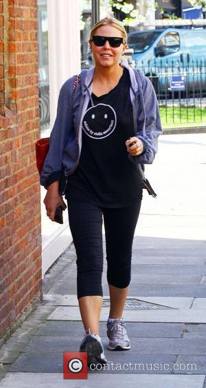 Patsy Kensit wearing a Addidas by Stella McCartney top makes her way to the gym after parking her car. London,...
