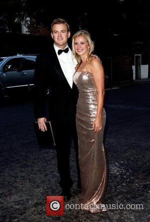 Freddie Andrews and Holly Branson arriving at a party hosted by Richard Branson at the Kensington Roof Gardens London, England...