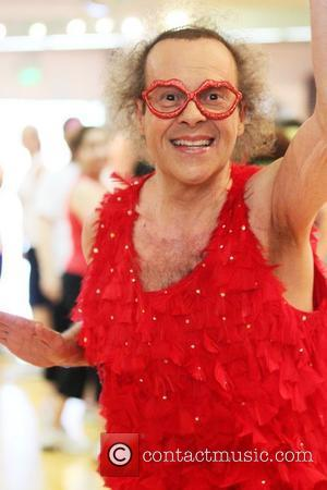 Richard Simmons The flamboyant fitness guru arrives at his aerobics dance studio dressed in a red feathered leotard and wearing...