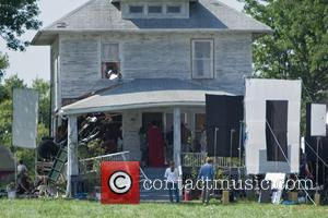 Henry Cavill dressed as Superman filming on the set of the new Superman movie reboot 'Man of Steel'. A small...