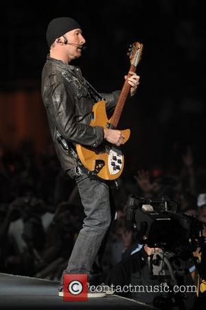 The Edge of U2 performing during the U2 360 Degree world tour at Sun Life Stadium Miami, Florida - 29.06.11