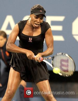 Venus Williams returns a serve during her match against Vesna Dolonts of Russia during Day One of the 2011 US...