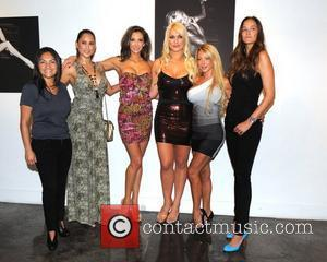 Michelle Pooch, Katrina Campins, Brooke Hogan and models attend their portrait unveiling at the Women In Cages exhibit at Cafeina...
