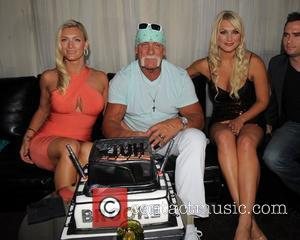 Hulk Hogan celebrates his 58th Birthday with his wife Jennifer McDaniel and his daughter Brooke Hogan during a portrait unveiling...