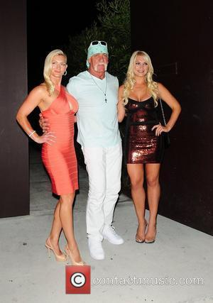 Brooke Hogan, Jennifer McDaniel and Hulk Hogan attend her portrait unveiling at the Women In Cages exhibit at Cafeina Lounge...