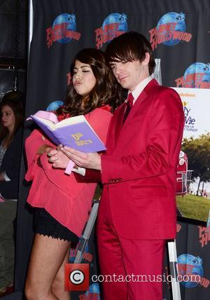 danielle monet, drake bell promote a fairly odd movie: grow up timmy turner! at planet hollywood times square, nyc 06-29-2011...
