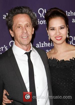 Brian Grazer and Guest The Alzheimer's Association's 19th Annual A Night At Sardi's  Held At The Beverly Hilton Hotel...