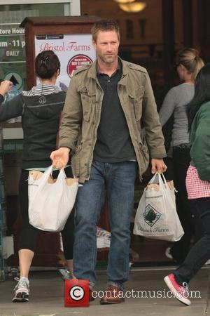 Aaron Eckhart Flew Cross Country For A Blind Date
