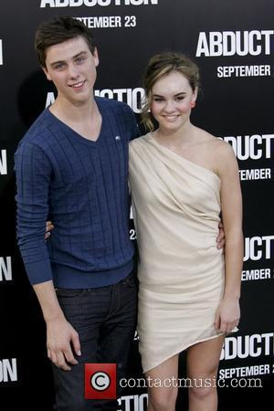 Sterling Beaumon, Madeline Carroll  The premiere of 'Abduction' held at the Chinese Theatre - Arrivals Los Angeles, California -...