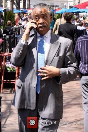 Al Sharpton talking on his cell phone after eating lunch at Cafe Du Parc Washington DC, USA - 11.04.11