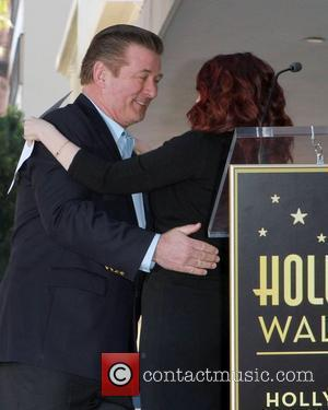 Alec Baldwin and Megan Mullally