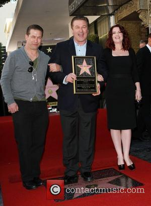 Stephen Baldwin, Alec Baldwin and Megan Mullally Alec Baldwin Hollywood Walk Of Fame Induction Ceremony Los Angeles, California - 14.02.11