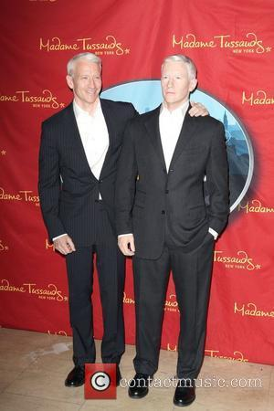 Anderson Cooper attends the unveiling and poses next to his new wax figure at Madame Tussauds in New York City...