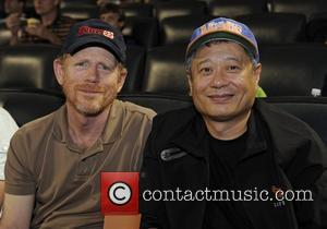 Ron Howard and Ang Lee are seen in the stands at the Mets vs. Atlanta Braves game held at Citifield...