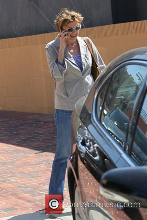 Annette Bening talking on her cell phone as she shops in West Hollywood Los Angeles, California - 22.06.11