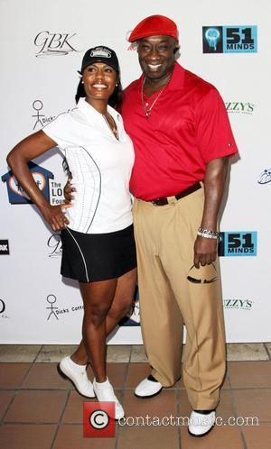 Michael Clarke Duncan and Omarosa The 4th Annual Lopez Foundation Celebrity Golf Classic held at Riviera Country Club Pacific Palisades,...
