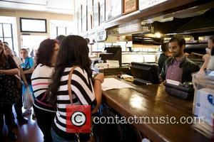 Aziz Ansari  serves pizza at Goathill Pizza to promote their new film '30 Minutes or Less' San Francisco, California...