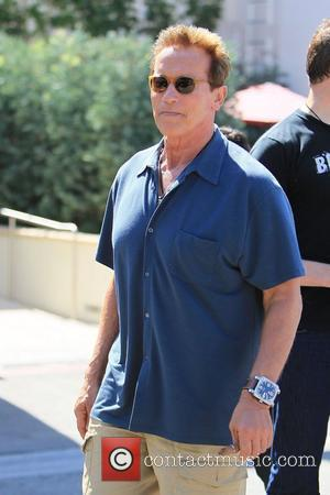Arnold Schwarzenegger seen leaving Cafe Roma in Beverly Hills Beverly Hills, California - 27.08.11