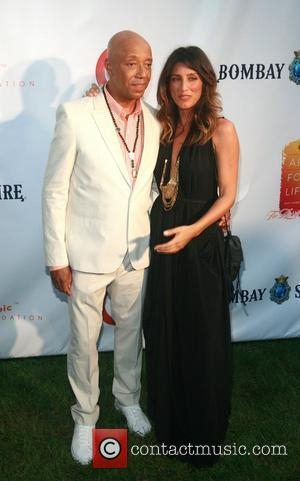 Russell Simmons and Jennifer Esposito  Russell Simmons' 12th Annual Art For Life East Hampton Benefit  New York City,...