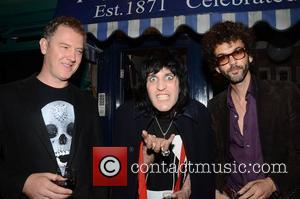 Noel Fielding and Christian Furr and Frankie Poullain from The Darkness ,  at the 'Art of Giving' fundraiser in...