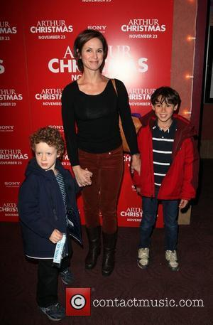 Elizabeth Vargas and sons Sam and Zachary Arthur Christmas MTA Shuttle unveiling at Grand Central Shuttle Station 42nd Street New...