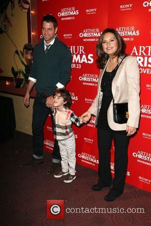 Peter Hermann and Mariska Hargitay and son August Arthur Christmas MTA Shuttle unveiling at Grand Central Shuttle Station 42nd Street...