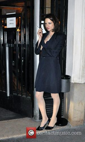 Actress Asia Argento smoking a cigarette outside Mathis bar. Paris, France - 24.01.11