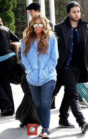 Aubrey O'Day out and about in flip flops and mirror aviator sunglasses. New York City, USA - 08.03.11