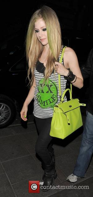 Avril Lavigne returning to her hotel at 2am. London, England - 02.06.11