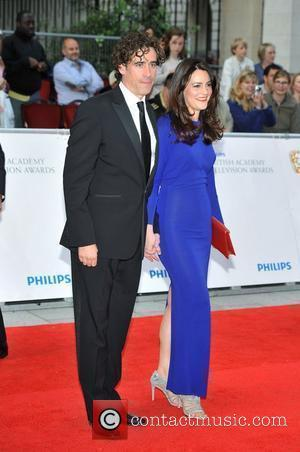 Stephen Mangan and guest Philips British Academy Television Awards in 2011 held at the Grosvenor House - Arrivals. London, England...