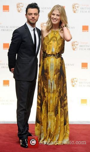 Dominic Cooper and Rosamund Pike