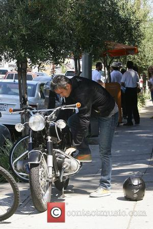 Balthazar is seen leaving the The Little Door restaurant and getting on his motorcycle in West Hollywood  Los Angeles,...
