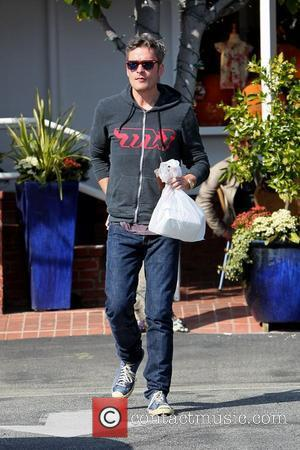 Balthazar Getty leaving Fred Segal with a shopping bag Los Angeles, California - 03.03.11