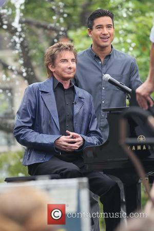 Barry Manilow and Mario Lopez at The Grove for the entertainment television news programme 'Extra' Los Angeles, California - 09.06.11