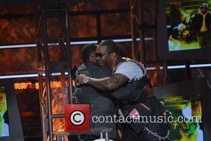 Malcolm-jamal Warner and Busta Rhymes