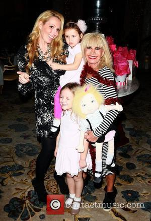 Betsey Johnson and Lulu Johnson and granddaughter Layla Johnson Betsey Johnson unveils the first ever Eloise Christmas tree, held in...