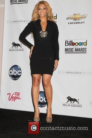 Beyonce Knowles, Bono, Adam Clayton