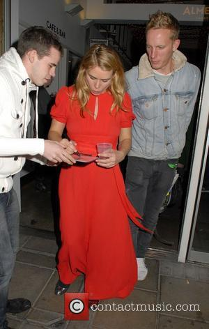 Pregnant Billie Piper and Laurence Fox,  leaving The Almeida Theatre after performing in the play, 'Reasons To Be Pretty'....