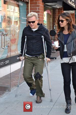 Billy Idol, real name William Broad, leaving a medical centre in Beverly Hills on crutches Los Angeles, California - 07.11.11