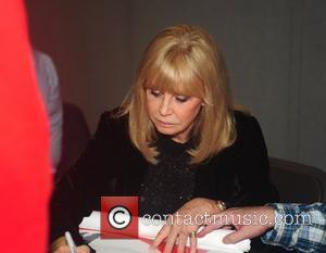 Britt Ekland Celebrities sign autographs at the Memorabilia Show at the NEC Arena Birmingham, England - 26.03.11