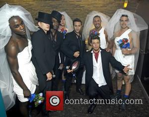 Lee Ryan, Simon Webbe, Antony Costa and Duncan James with dancers dressed as brides Blue perform live at G-A-Y London,...