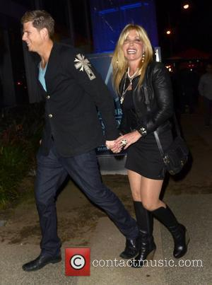 Pamela Bach visits BOA Steakhouse in West Hollywood with a younger man Los Angeles, California - 02.04.11