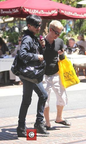 Bobby Trendy brushes his hair with a pink hair brush as he walks in The Grove Los Angeles, California -...
