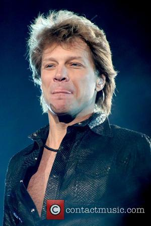 Jon Bon Jovi performing live on stage at The Air Canada Centre. Toronto, Canada - 14.02.11